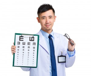 Optician doctor with eye chart and eye glasses