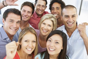 Elevated View Of Happy And Positive Business People In Casual Dr
